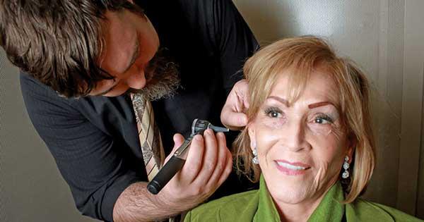 Woman recieving a hearing exam | El Paso TX