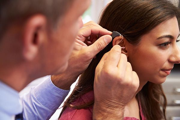 Audiologist fitting over the ear hearing aid - El Paso TX