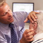 Man being fitted with hearing aids in El Paso